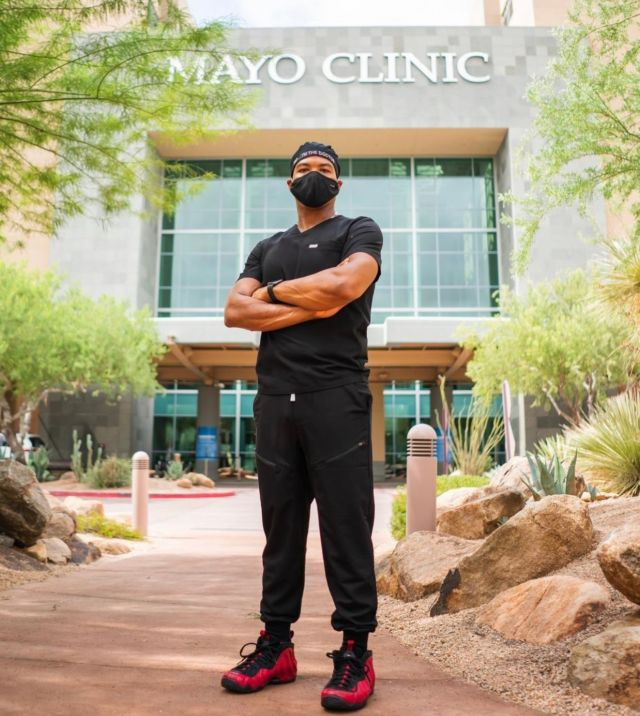 """@ajmilammdphd• Mayo Clinic • Cardiothoracic Anesthesiologist . . """"Because I'm still celebrating….new city! New job! Finally a paycheck! What should we call this chapter?"""" . Be sure to use the link in our bio to make your #MelaninMerch purchase and join the  Melanin Doc family!  www.melanindocs.com/shop • • • •  #blackexcellence #minorities #theshaderoom #daquan #motivation #doctor #medicine #love #instagood #tbt #happy #followme #fun #life #melanin #black #beautiful"""